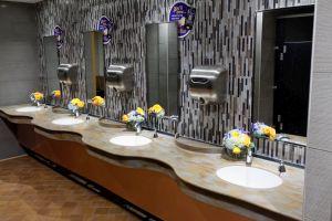 Flowers decorate countertop in the restroom. - , Utah