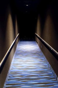 After passing through the auditorium door, a short hallway slopes up, with a right turn at the end. - , Utah