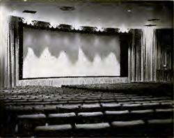 """""""View with contour and traveler curtains open shows the 50x22-foot Technikote screen."""""""