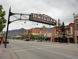 An arch welcoming visitors to Brigham City spans Main Street, obscuring the front of the Capitol Theatre from the south. - , Utah