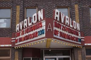 Above the entrance of the Avalon hangs a traditional triangular marquee, with a two-line attraction board.