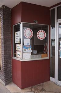 Movie start and end times are displayed in the window of the ticket booth. - , Utah