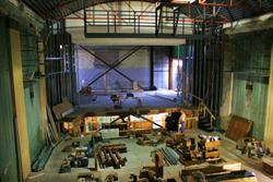 Components of the Utah Theatre's new pipe organ are laid out on the floor of the auditorium.