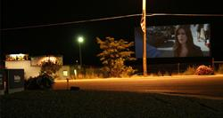 A movie on the screen of the Sunset Drive-In in 2007. - , Utah