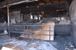 "Interior of the concessions building.  The fire chief described the building as <span style='font-family: 'Times New Roman'; font-size: medium;'>""completely destroyed"" and ""a total loss.""</span>"