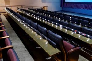 All rows, except the first, have a narrow table attached to the back of the seats in front. - , Utah