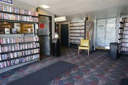 The lobby of the Tower Theatre serves as a video rental store. An office is on the left, the concession stand out of the photo on the right.