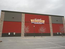 A Megaplex Theatres logo on the west exterior wall.