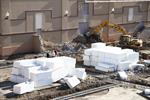 Five construction photos.