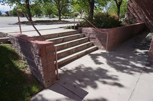 Stairs down from the front sidewalk to the auditorium exits. - , Utah