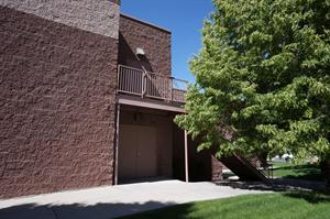 A second-level exit for the projection booth, above the exit doors for the main hallway. - , Utah