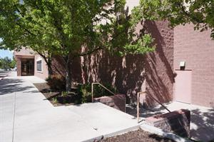 Sidewalk and stairs along the right side of the theater entrance. - , Utah