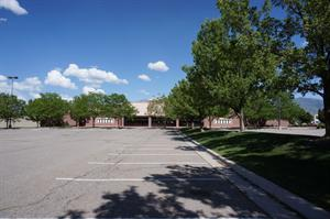 Trees line a strip of lawn in the center of the parking lot. - , Utah