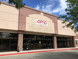 A temporary banner for AMC Theatres replaces the Carmike Cinemas sign above the theater entrance. - , Utah