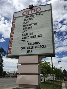 The AMC logo now displays above the attraction board along Redwood Road. - , Utah
