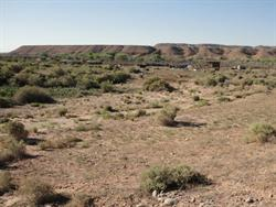 Looking south at the possible site of the Montezuma Creek Drive In. Ridges in the ground may indicate two rows of parking facing west. - , Utah