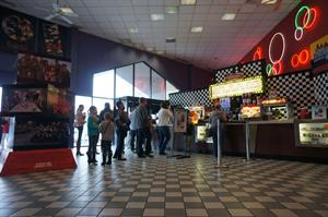 A line of moviegoers wait at the concessions stand. - , Utah