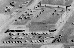A 1955 aerial view of the building that would later be remodeled into Movies 10.