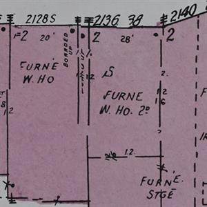 2128 South 1100 East on a 1949 Sanborn fire insurance map was a furniture business connected to nearby store fronts.