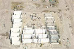 Aerial view of construction.  The walls of 11 theaters are up.  The theaters form a U shape.