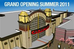 A rendering of the entrance of the Cinemark at Station Park, with retail buildings along the sides.