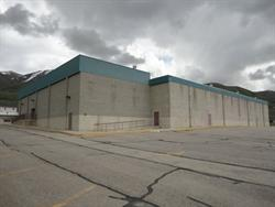 The north and west exterior walls. The original four screens are on the right. The taller portion of the building on the left includes two of the newer auditoriums.