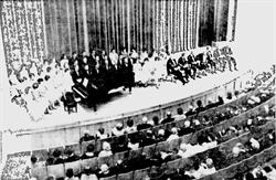 Church, educational, and civic leaders sit on the right side of the stage at the dedicatory exercises of the Pioneer Memorial Theatre.  On the left is the University of Utah A Cappella Choir. - , Utah