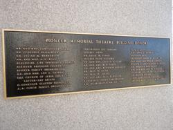 A plaque on the right side of the entrance, next to the ticket window, lists the original donors for the Pioneer Memorial Theatre. - , Utah