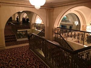 Stairs from the mezzanine to the lobby, on the east side.  A matching staircase is in on the west side. - , Utah