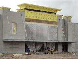 A large sheet of plastic covers the entrance of the theater as work begins on finished the exterior walls. - , Utah