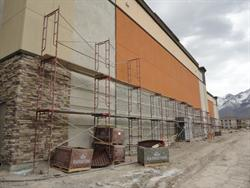 Pallets of stone near scaffolding along the south exterior wall. - , Utah