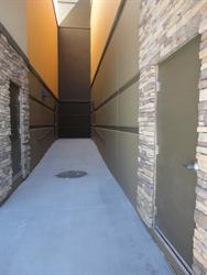 Doors at the end of this alley provide exits from the mid-length of the auditoriums. - , Utah