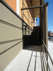 Stairs on the east side provide access to the projection level. - , Utah