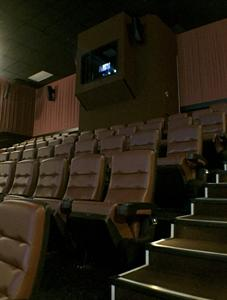 The projection booth extends into the last row of seating, with doors on either side to provide access to the equipment. - , Utah