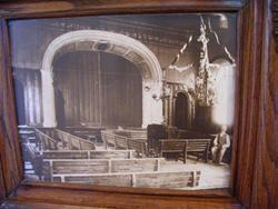 A framed photograph of the hall, with the proscenium arch at the far end.