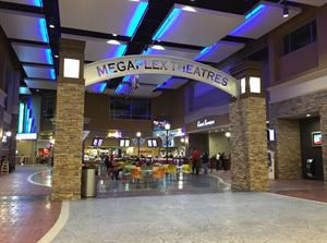 The theater entrance from inside the mall features the name, Megaplex Theatres, arcing between to pillars. - , Utah