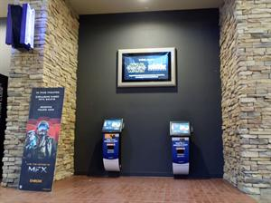 A pair of ticketing kiosks, sponsered by America First Credit Union, in the main lobby. - , Utah