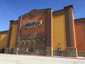 The Larry H. Miller Megaplex Theatres sign in the center of the south exterior wall. - , Utah