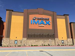 The Washakie Renewable Energy appears above the IMAX Theatre logo on the east wall of the theater. - , Utah
