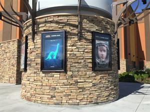 Posters line the circular base for the theater's sign. - , Utah