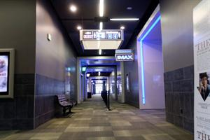 Looking east down the north hallway. An exit is on the left, the IMAX hall on the right. - , Utah