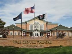 A curving brick wall bears the name of Hale Centre Theatre at Harmon Hall. - , Utah