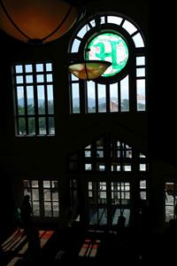 A stained-glass letter H stands above the main entrance doors in the lobby. - , Utah