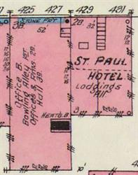 A stone front building with a hall on the third floor appears on the 1906 Sanborn fire insurance map.