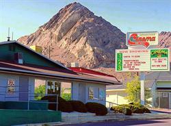 A rocky peak rises behind the Wendover Cinemas. - , Utah