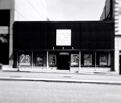 A black and white photo of the Children's Theatre, from across the street.