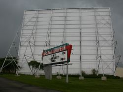 The sign of the Basin Drive-In, with the screen tower behind it. - , Utah