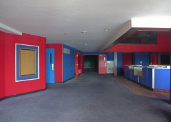 The lobby of the theater.  The entrance to one of the larger auditoriums is straight ahead.  On the left is the door to one of the smaller ones.  The other two theaters are on the other side of the concession stand, shown here on the right.