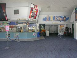 The lobby of the theater, with the concession stand on the left and the hallway to the theater auditoriums on the right.
