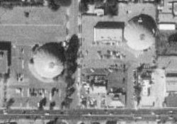 An aerial photo of the old Century Theaters in 1997.  The Century 21 building is on the left, with the line of trees visible along 200 East.  In the upper right is the Century 22 building with the four-screen extension on its left side. - , Utah